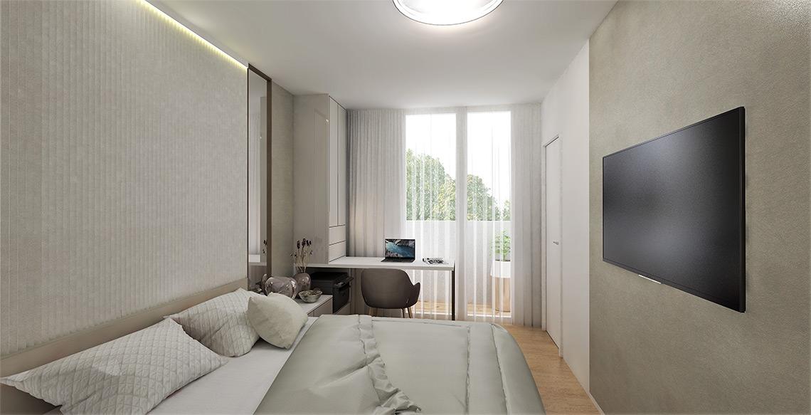 Součástí ložnice je pracovní místo, které je opět u okna, abychom využili hezké výhledy do dálky z nejvyššího patra budovy