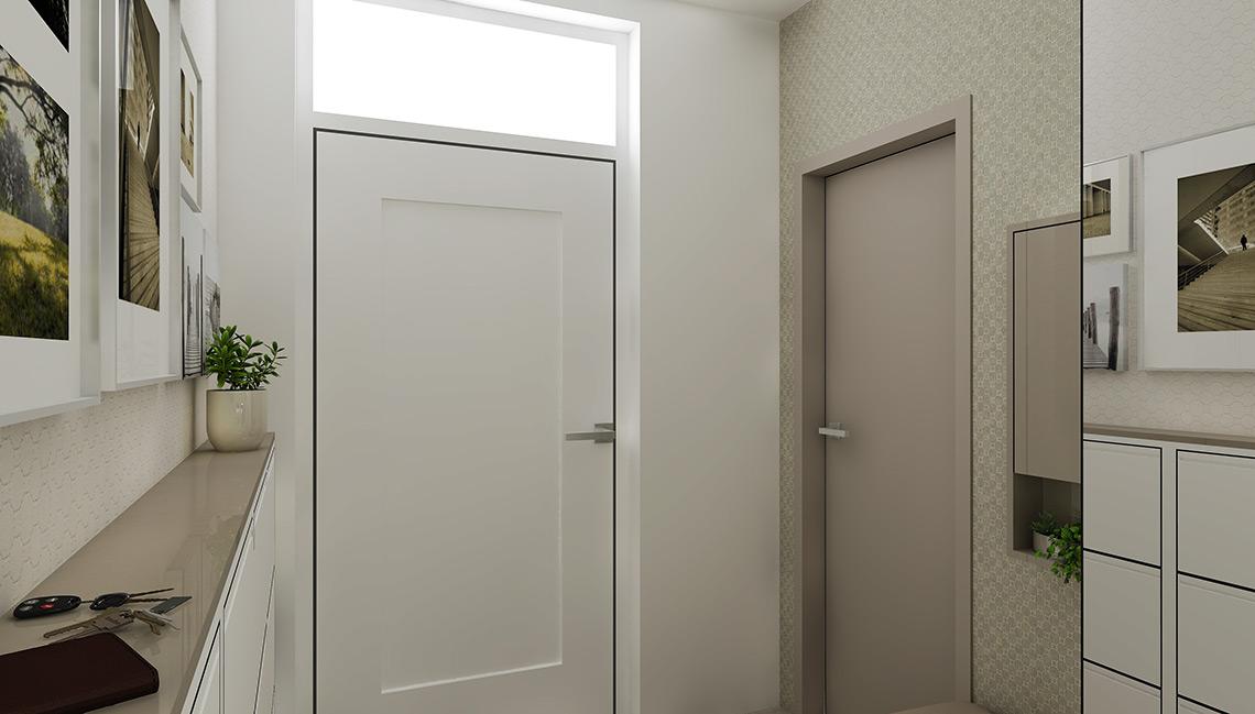 Také v zádveří je použita tapeta s drobným geometrickým vzorem – zde ve dvou odstínech, za vchodovými dveřmi šedo-hnědá a naproti zrcadlové stěně bílá, obě mají ve vzoru metalické odlesky, které vyniknou zejména při umělém osvětlení