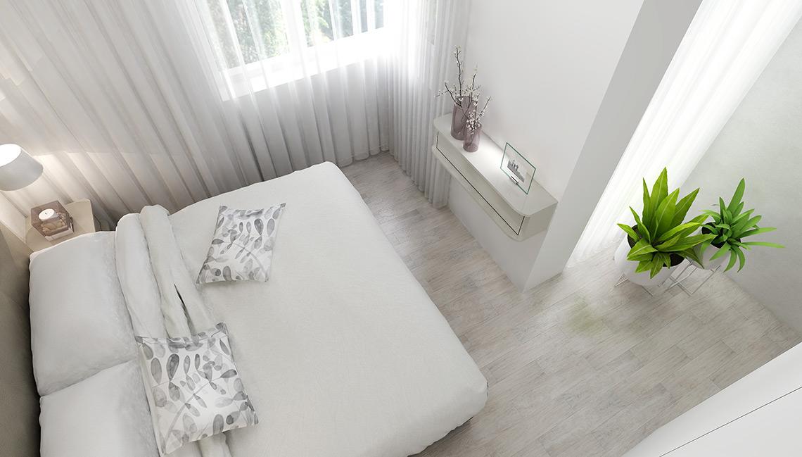 Celou místnost zjemňují záclony, které jí dodávají útulnost, jemné barvy zase podporují odpočinek a relaxaci