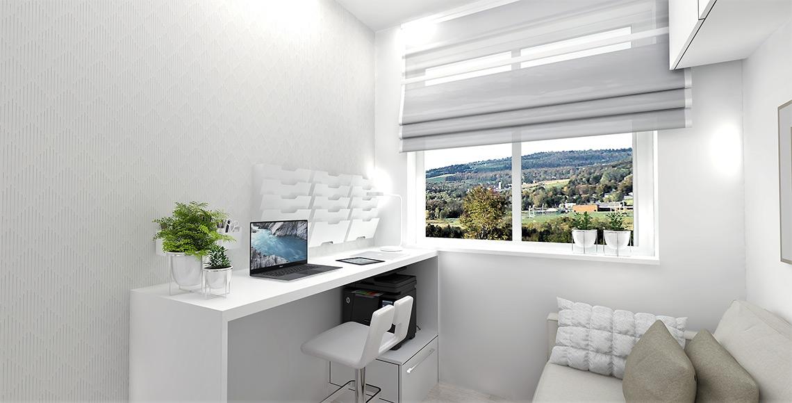 Pracovní stůl je zvýšený s barovým sezením, aby židle nepřekážela průchodu k oknu, pod ním je velká tiskárna na výsuvném kontejneru, který lze pod dokončení práce opět schovat pod stůl