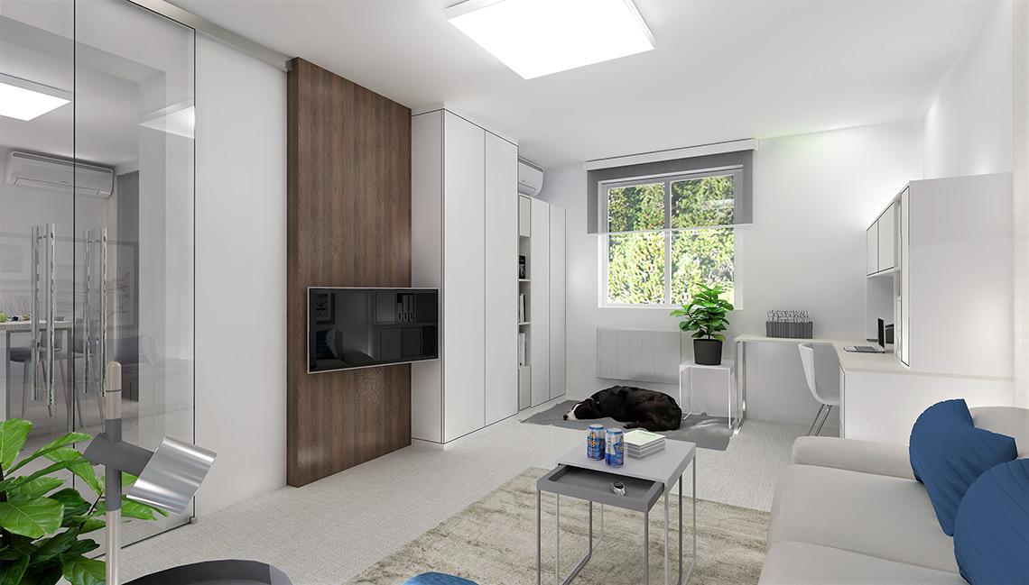 Obývací pokoj s prostorným pracovním koutem je od kuchyně oddělen skleněnými dveřmi, aby do místnosti přiváděly světlo z verandy