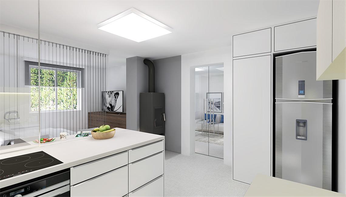 Kuchyňský kout obsahuje vše potřebné na malém prostoru – varnou desku, barové sezení, ledničku a vysokou spížní skříň